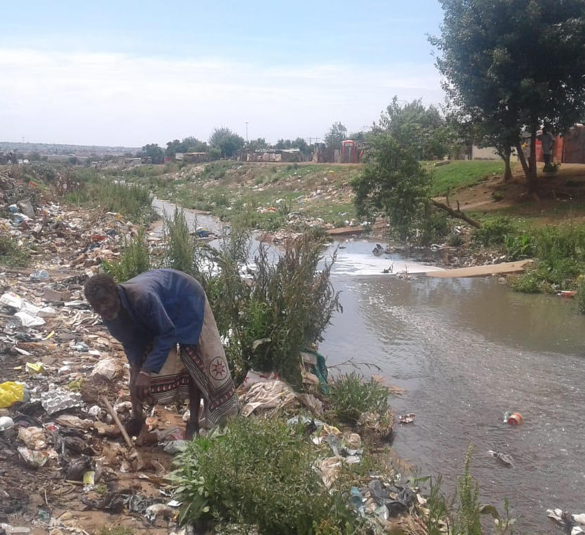 Hennops River Restoration and Clean Up Campaign - Garbage being dumped in riverbad