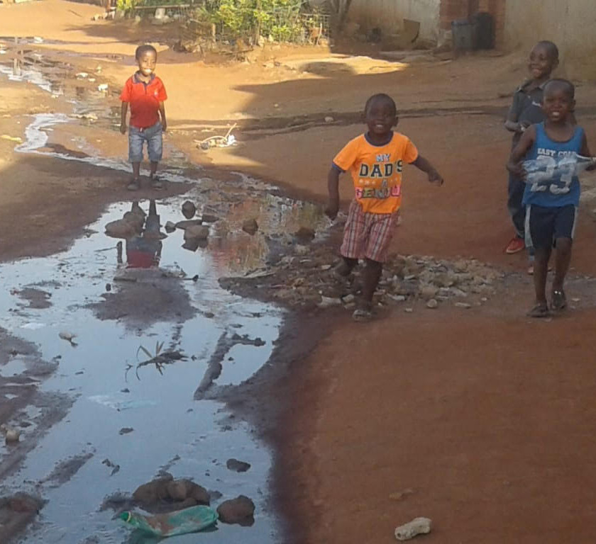 Hennops River Restoration and Clean Up Campaign - Children playing around sewage flow