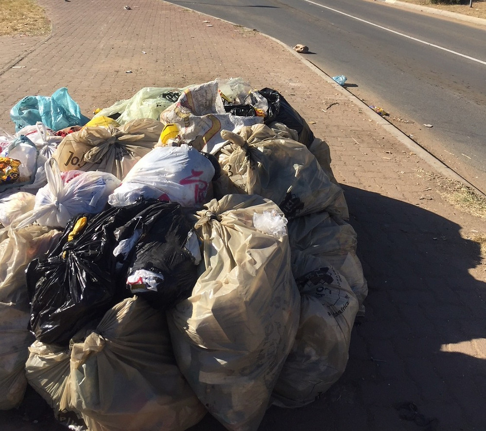 Hennops Blue_Ivory Park, South Africa_Household refuse is placed in plastic bags on street corners for collection.