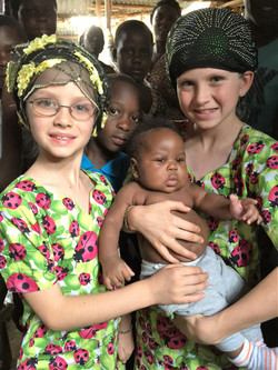 In the market - the girls led the baby's mom to Christ