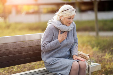 woman-with-chest-pain-sitting-on-a-bench