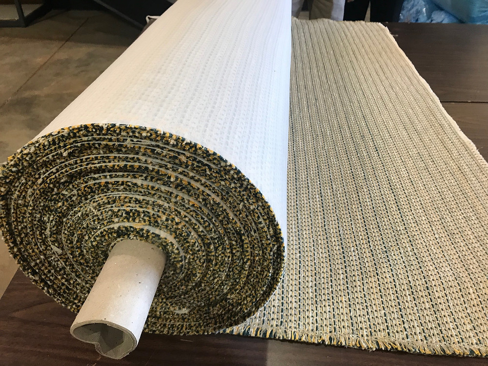 Photo showing a roll of finished knit-backed fabric, now ready to use for upholstery.