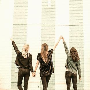 three woman holding hands white walking_