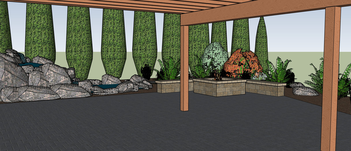 View from under dry deck looking out at the near by water feature and lovely plantings.