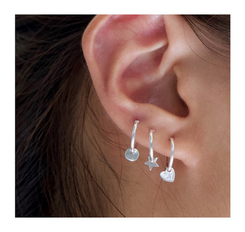 2ddb9358cd0416 -includes one hoop earring (sold separately)