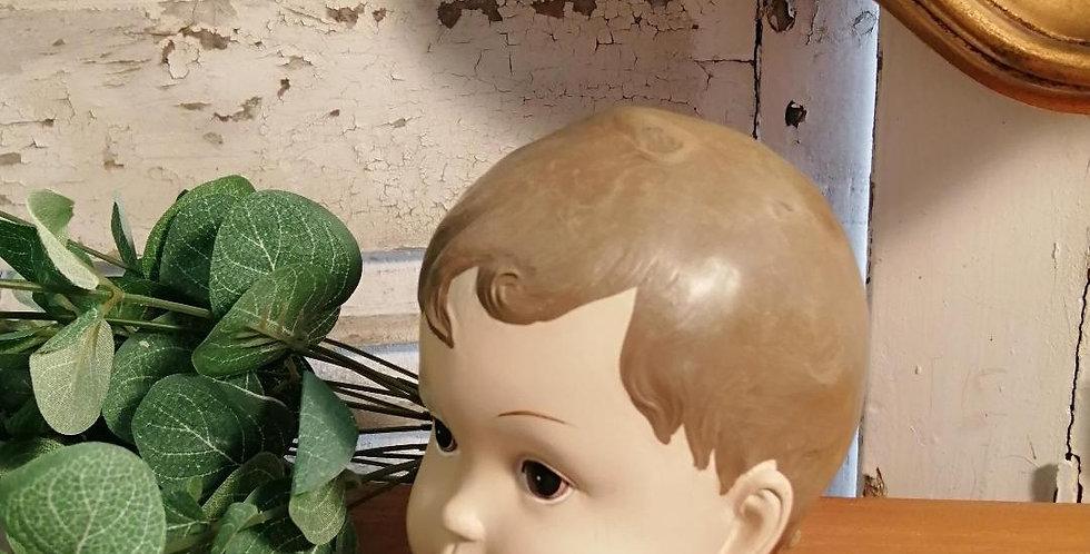 Tête de poupée