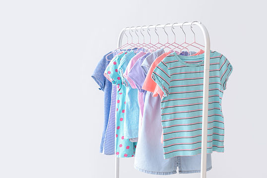 stylish-kid-clothes-hanging-rack-against