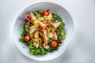 fresh salad with seasonal vegetables and chicken breasts in Dida Boža restaurant