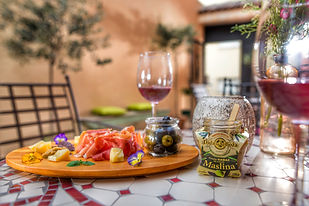 cold plate with olive spreads, cheese and charcuterie, enjoyed with wine glasses