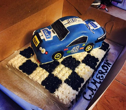 Facebook - Bit of a last minute cake for my daycare kiddo's NASCAR Party.jpg