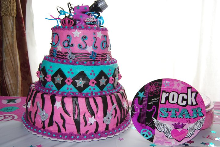 Facebook - Dasia's Rock Star Diva Cake! Double Layers of lemon (top and middle)