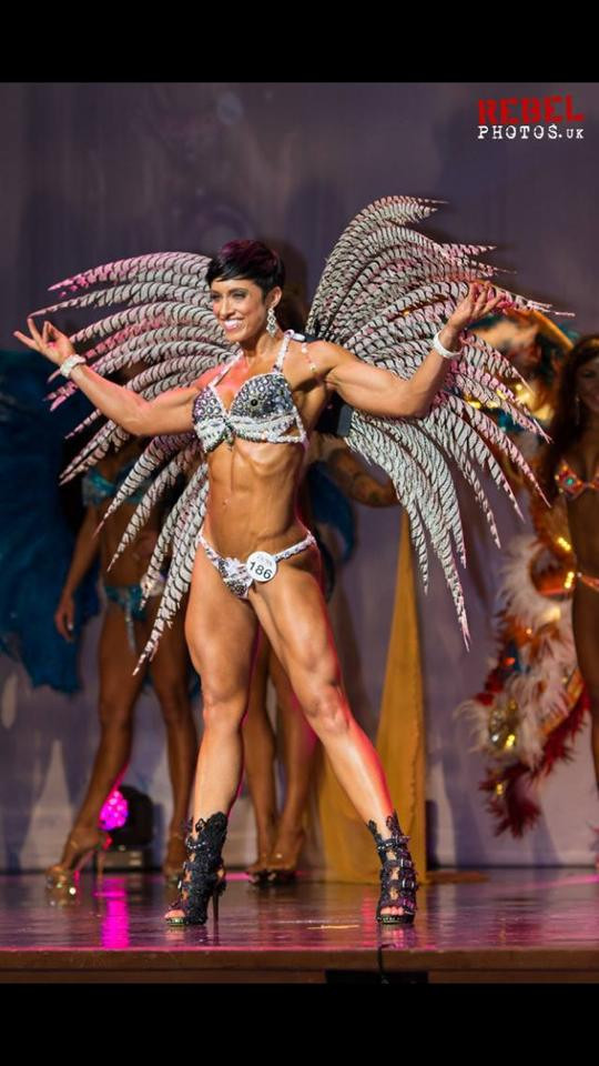 model on stage wearing bikini and feather wings