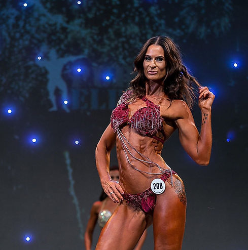 Fitness model wearing a Burgundy lace diva competition bikini