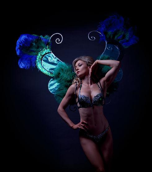 model dressed in green crystal bikini top and wings