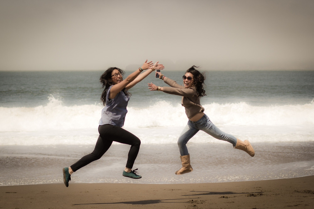 girls jumping on the beach, girls on the beach
