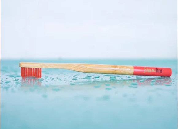 Red handled bamboo toothbrush by eco bru