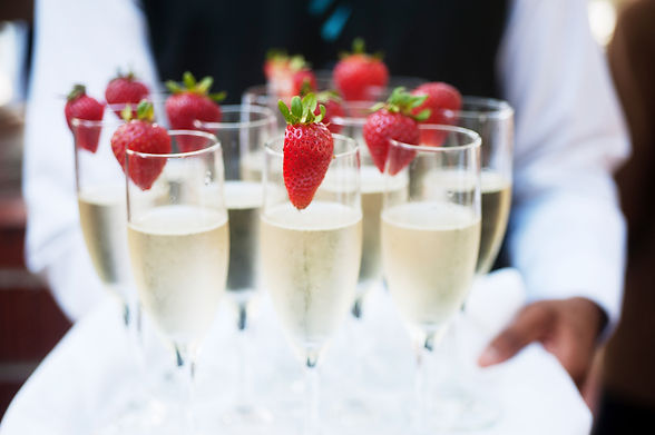 Waiter serving champagne on a tray.jpg