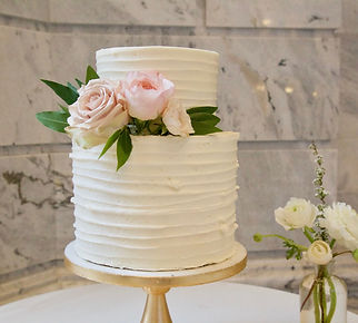 White Wedding cake with pink roses.jpg