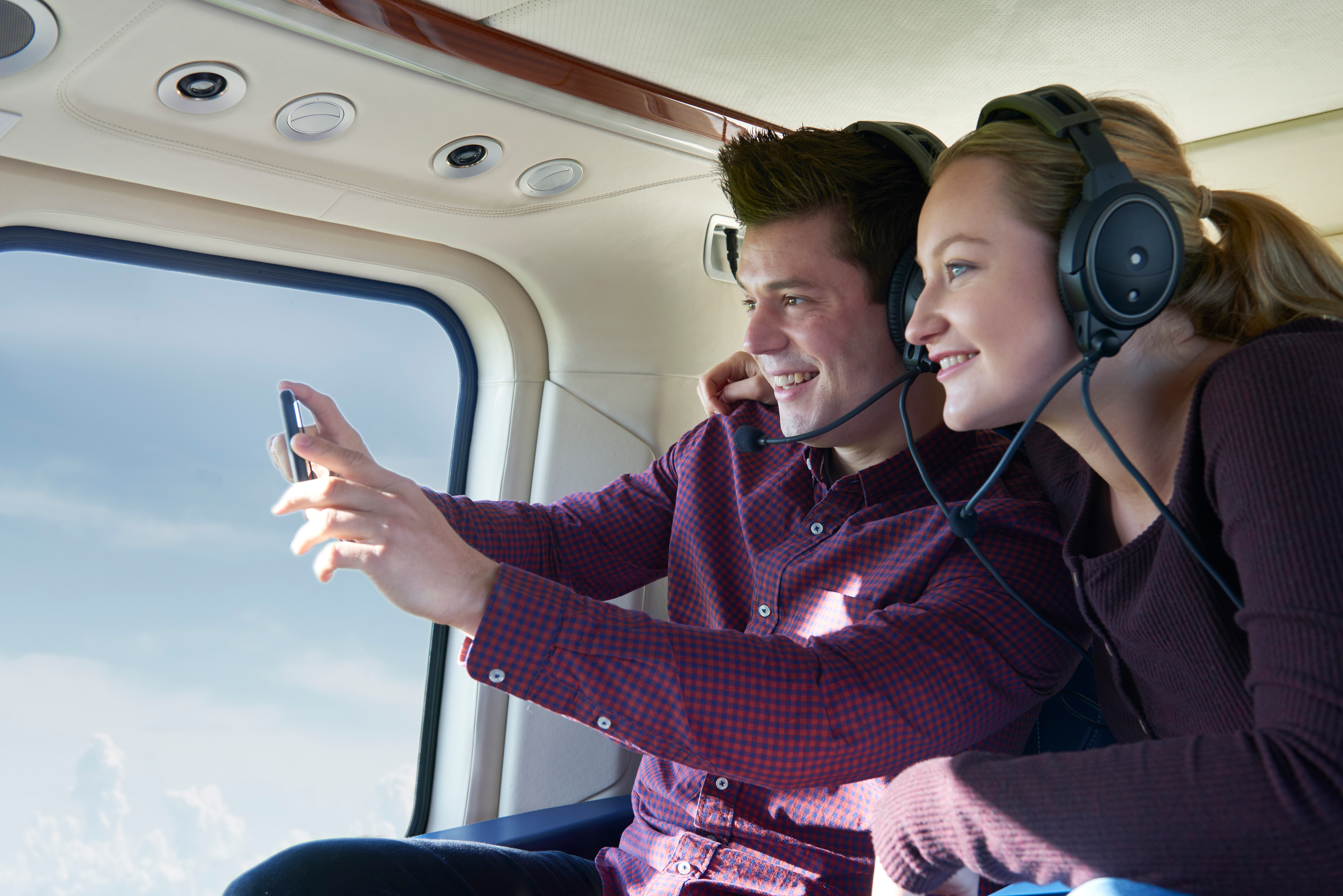 Couple On Vacation Taking Ride In Helico