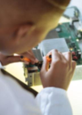 faceless-professional-repairer-fixing-vi