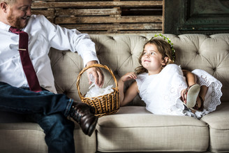 Flower girl on the couch with best man.J