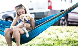 Dog and Girl on Hammok.jpg