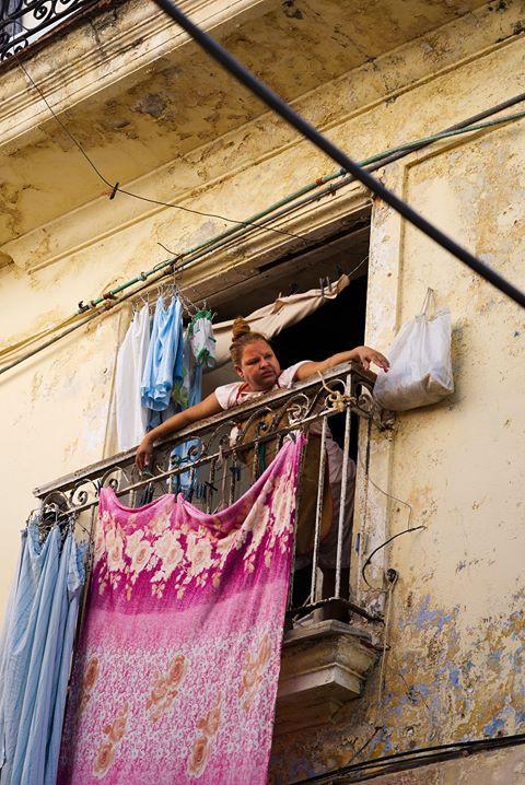 woman in balcony cuba