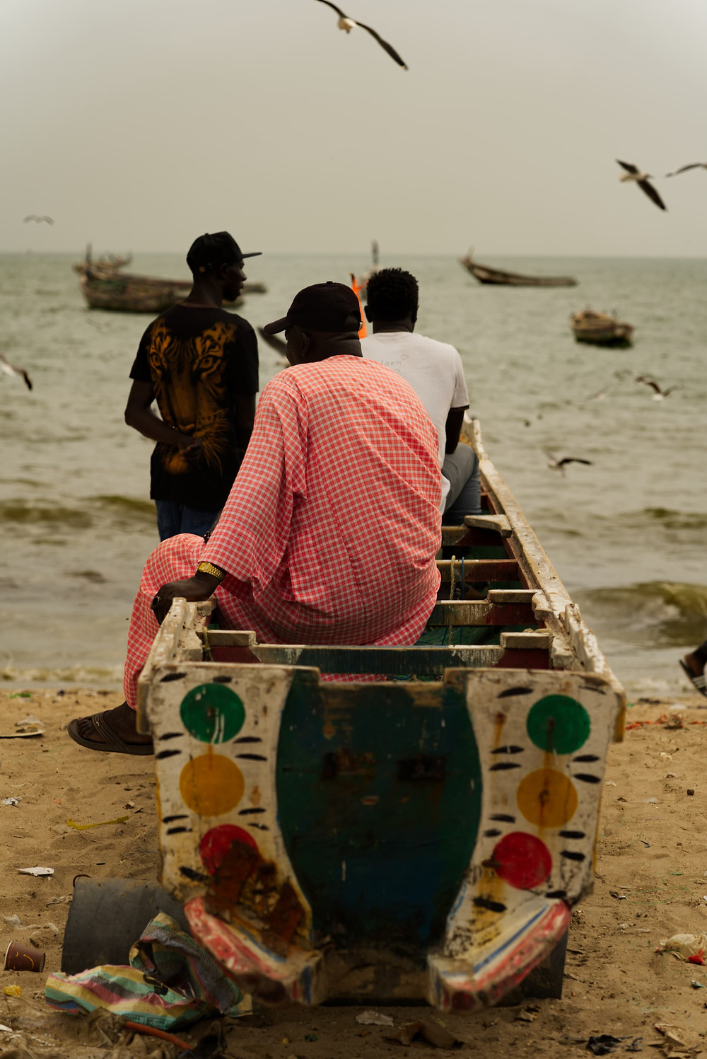 fishermen look out to sea in gambia
