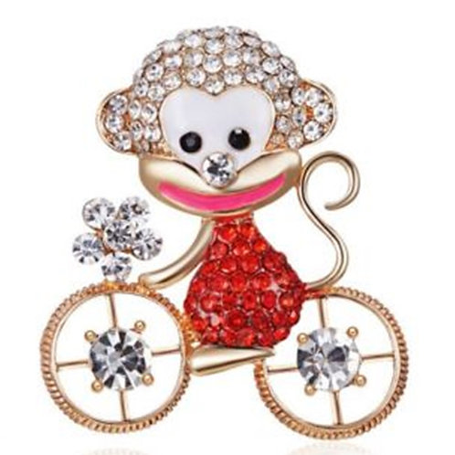 Gold Crystal Monkey on Bicycle Brooch