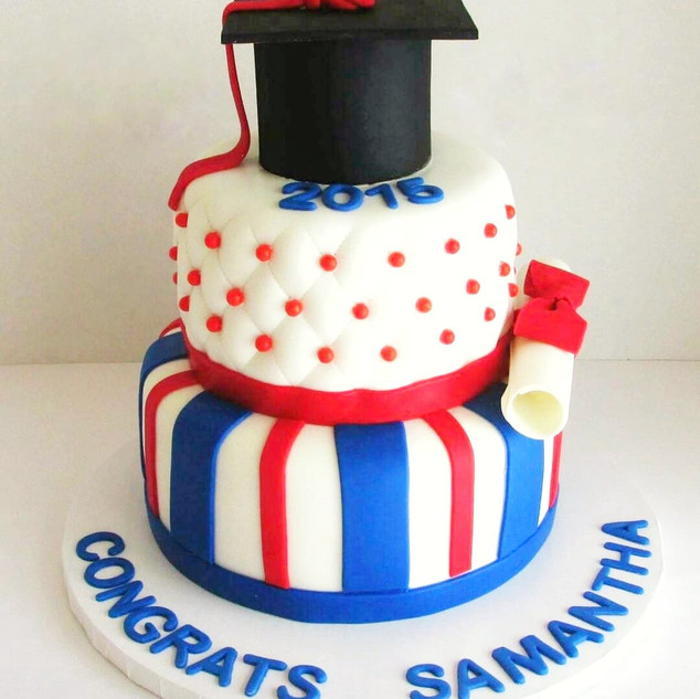Blue and red 2 tier graduation cake