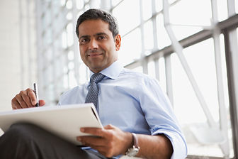 Businessman in a shirt and tie reading a report