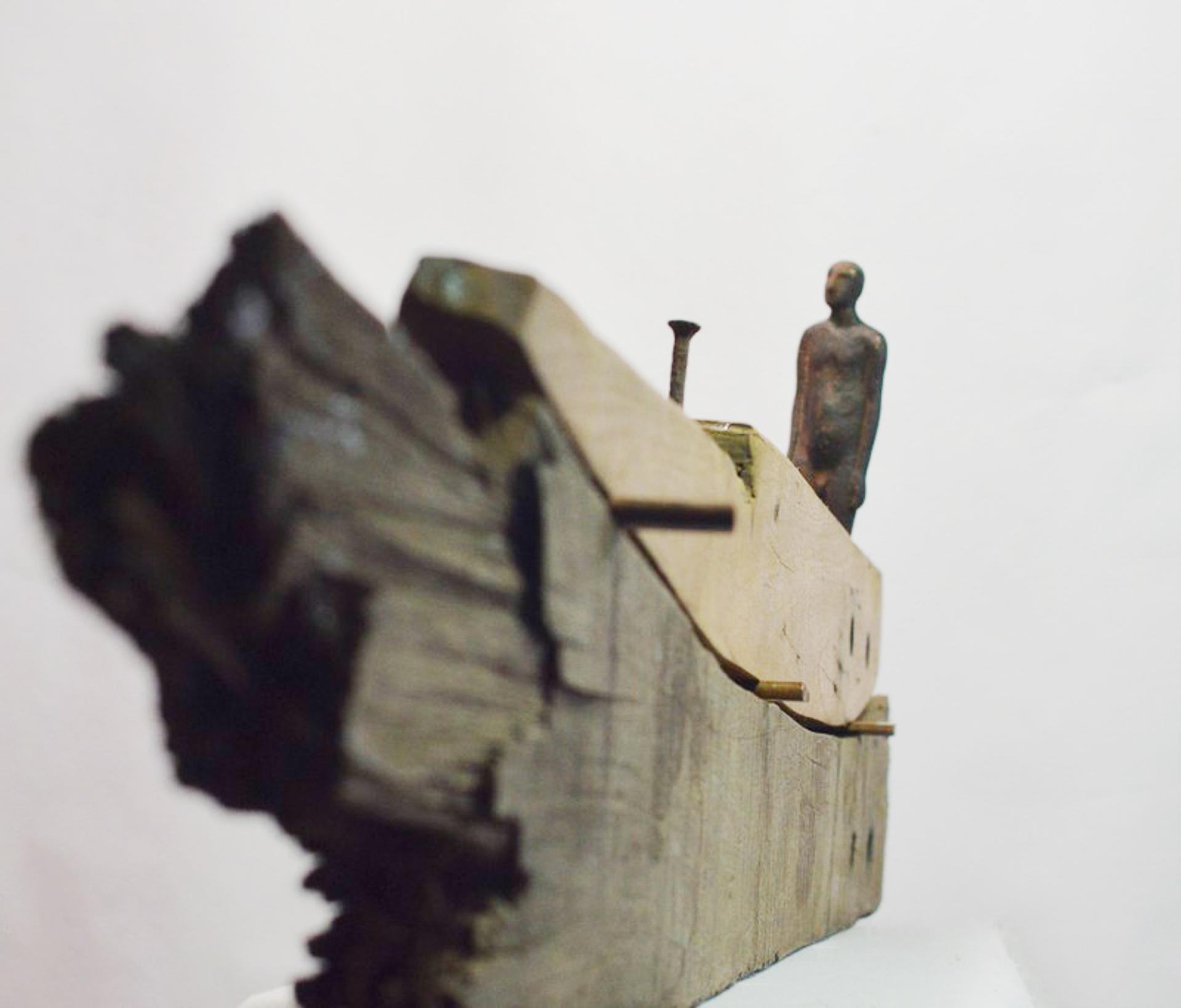 11. Balsa hierro dos maderas y clavo