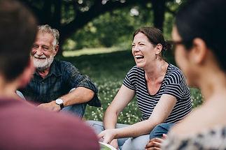 Community-group-friends-sat-together-smiling.jpg