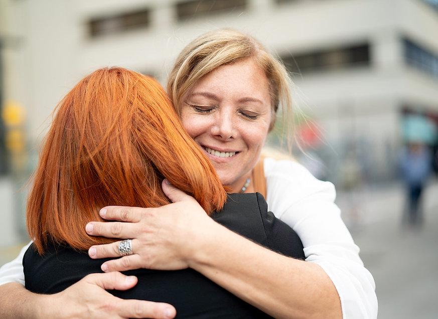 Two-women-friends-hugging.jpg