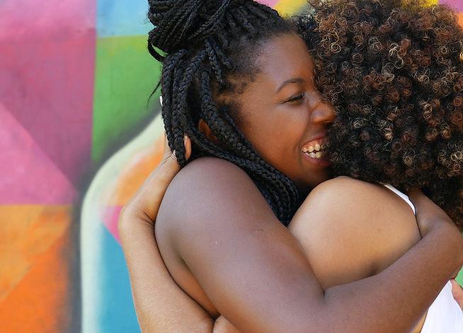 Two-women-friends-hugging-happily.jpg