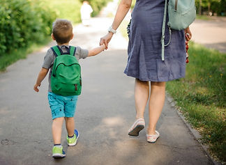 Mum-and-son-walking-down-path-together_e