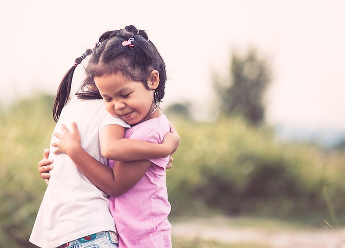 Two-young-girls-hugging-friends_edited.j