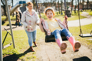 young-girl-on-swing-smiling.jpg