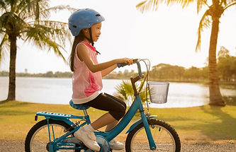 young-girl-riding-her-bike-smiling_edite
