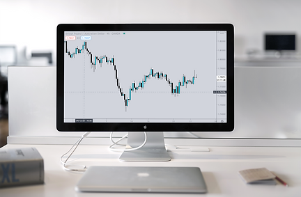 A mac with a trading screen