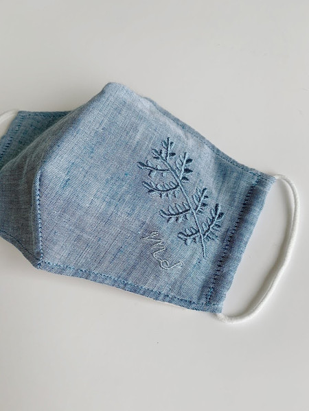 Embroidered facemask in blue linen