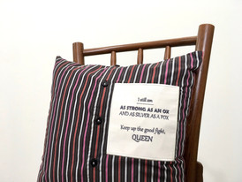 Embroidered message appliqué on shirt cushion
