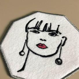 Embroidered sketch portrait