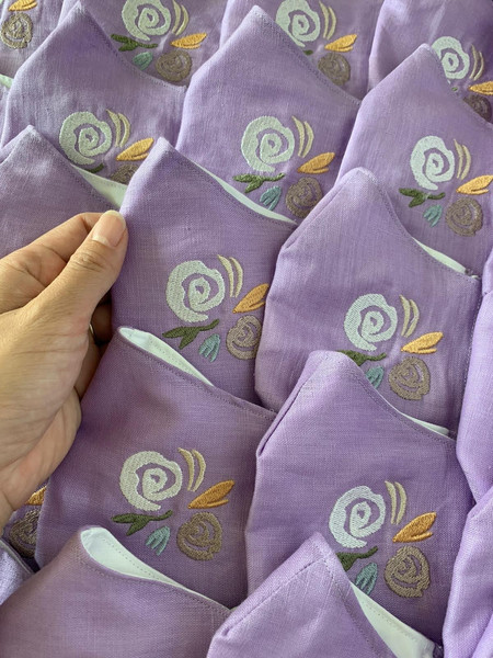 Rose embroidery on purple linen