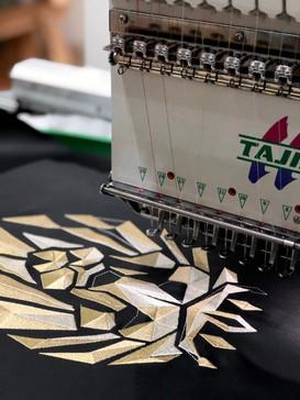 Geometric lion embroidery