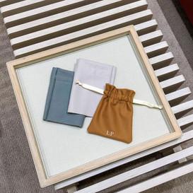 Monogrammed cashmere pouches