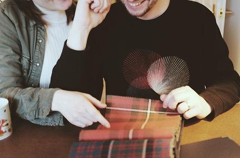 image of couple choosing a tartan