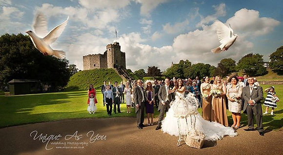 Bride & Groom releasing white doves from Cardiff Castle