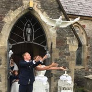 Release doves at Llanharry Church South Wales