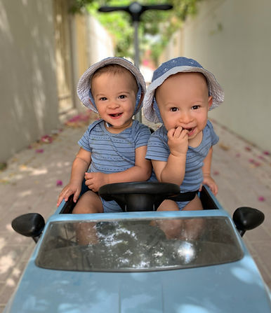 twins wearing blue hats and organic cotton clothes